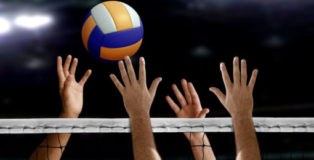 76867779 - volleyball spike hand block over the net